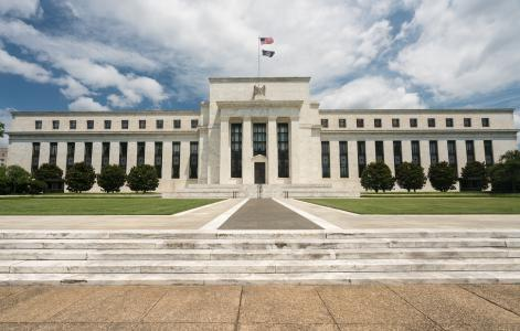 Fed lowers interest rates again