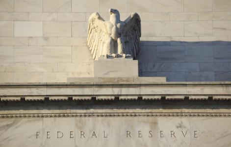 Fed raises rates, but dials back plans for future hikes