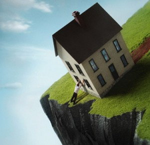 Man leaning against house near cliff